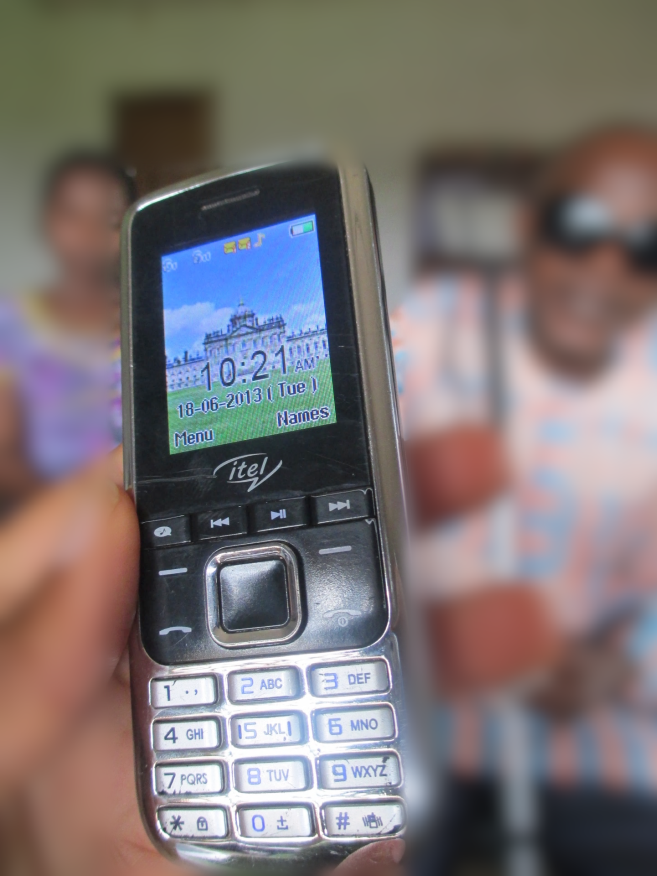 Image of mobile phone held by a blind man